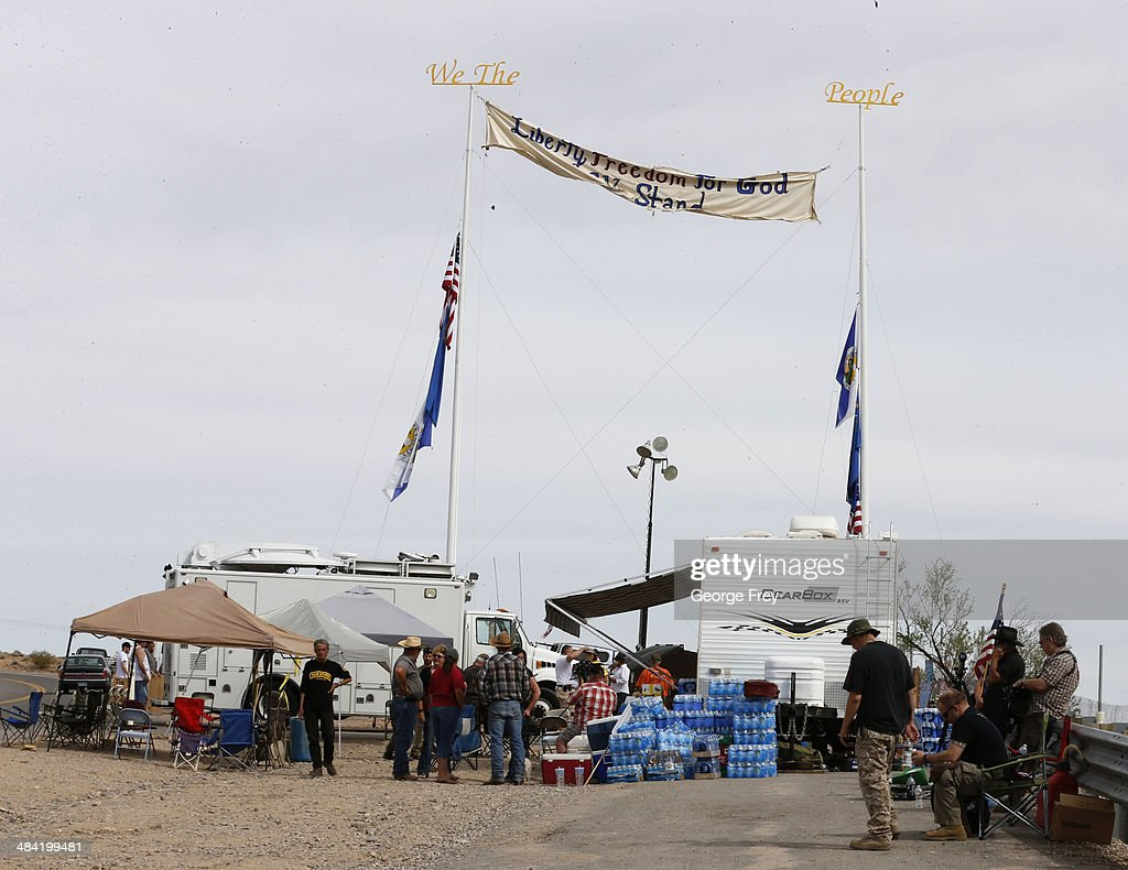 People gather at a protest area along U.S. 170 April 11, 2014 west of Mesquite, Nevada. Bureau of Land Management officials are rounding up Cliven Bundy's cattle, he has been locked in a dispute with the BLM for a couple of decades over grazing rights. (Photo by George Frey/Getty Images