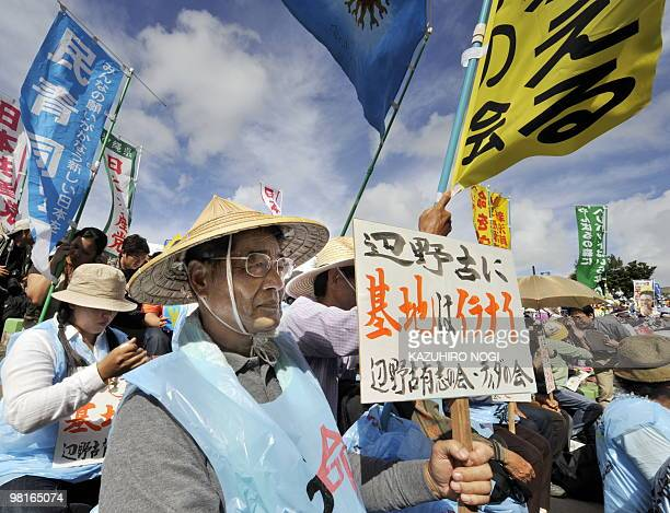 People gather at a rally against the US military base in Ginowan Okinawa Prefecture on November 8 2009 Thousands attended the rally against the US...