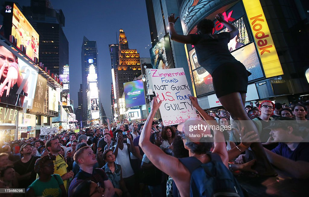 People gather at a rally in support of Trayvon Martin in Times Square while blocking traffic after marching from a rally for Martin in Union Square in Manhattan on July 14, 2013 in New York City. George Zimmerman was acquitted of all charges in the shooting death of Martin July 13 and many protesters questioned the verdict.