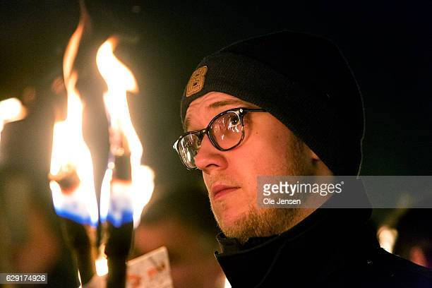 People gather at a torchlight procession in remembrance of murdered police officer December 11 2016 in Albertslund Denmark Police officer Jesper Jul...