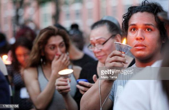 People gather at a vigil for slain transgender woman Islan Nettles at Jackie Robinson Park in Harlem on August 27 2013 in New York City Nettles was...