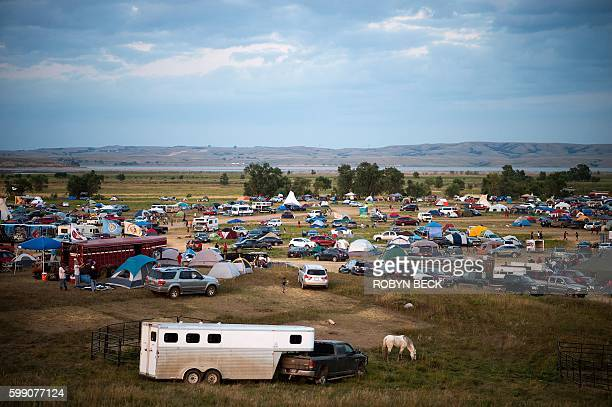 People gather at an encampment by the Missouri River where hundreds of people have gathered to join the Standing Rock Sioux Tribe's protest against...