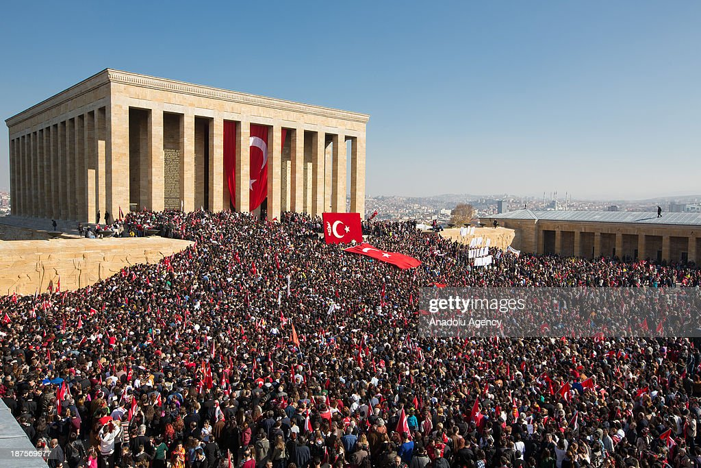 People gather at Anitkabir (mausoleum of Mustafa Kemal Ataturk) and wave Turkish flags during a ceremony marking the 75th anniversary of his death on November 10, 2013 in Ankara, Turkey. Turkey has commemorated its national hero, founder of the Republic of Turkey, Mustafa Kemal Ataturk who passed away 75 years ago. Mustafa Kemal Ataturk died at 9:05 a.m. on November 10, 1938 at the age of 57.