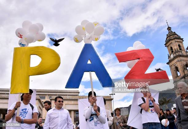 TOPSHOT People gather at Bogota's Bolivar main square on September 26 to celebrate the historic peace agreement between the Colombian government and...