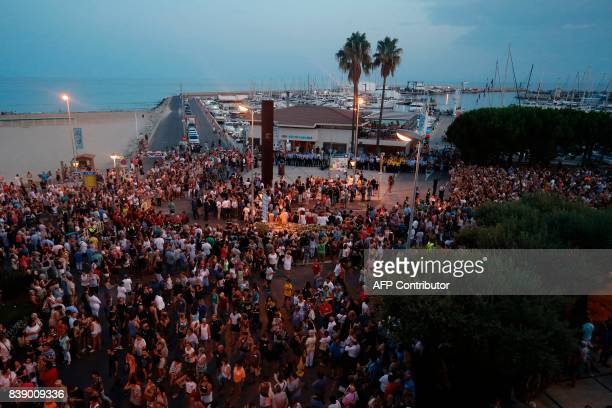 People gather at Cambrils' harbour as they protest against terrorism following Barcelona and Cambrils attacks on August 25 one week after a van...