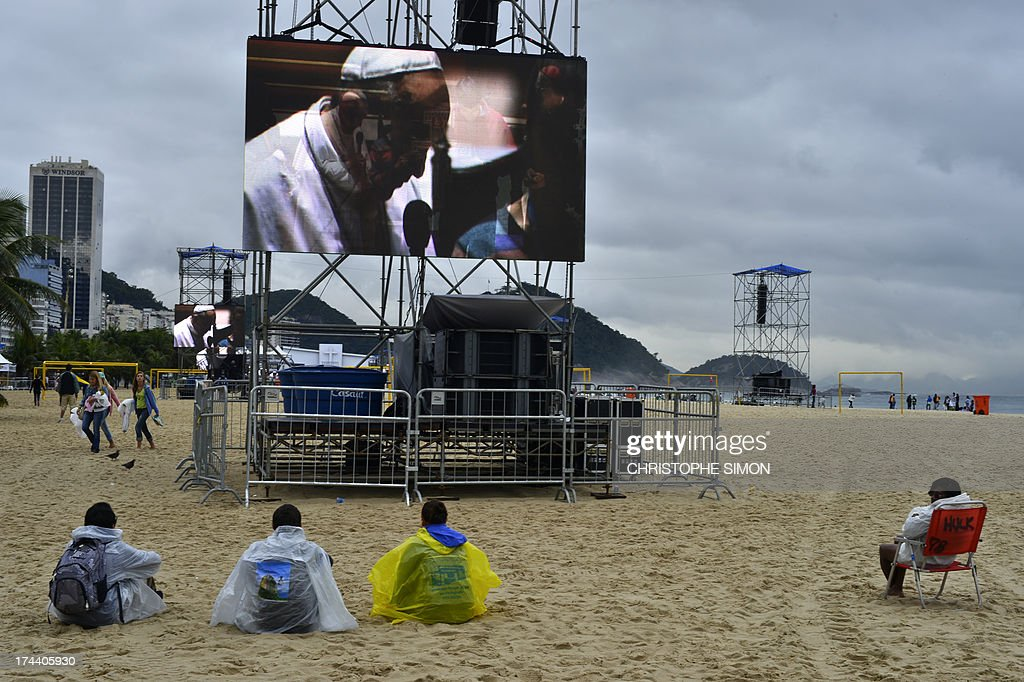 People gather at Copacabana beach where in the evening, Pope Francis will be officially welcomed by crowds of young Catholics attending World Youth Day (WYD) on July 25, 2013. Pope Francis urged young Brazilians not to despair in the battle against corruption Thursday as he addressed their country's political problems in the wake of massive protests.