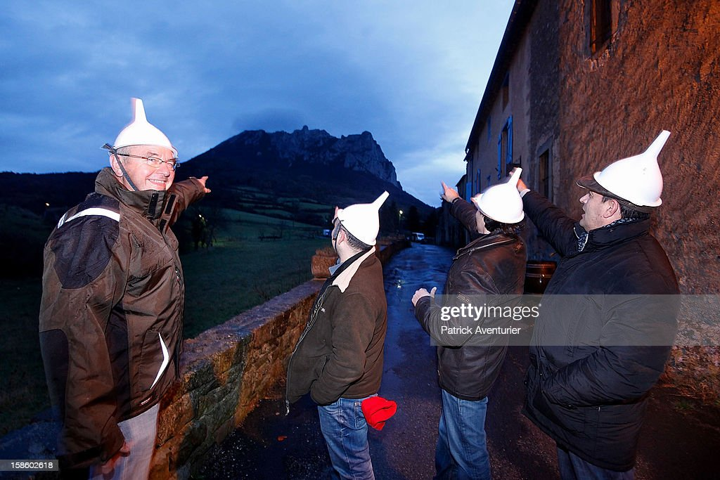 People gather at dusk in Bugarath, a small village in the foothills of the Pyrenees on December 20, 2012 in Bugarach, France. Miviludes, the French Government's dedicated sect watchdog, are investigating the likelihood of apocalyptic sect activity or ritualised suicides due to the prophecy of an ancient Mayan calendar which also claims that Burgarach is the only place on Earth which will be saved from the apocalypse on the evening of December 21, 2012.