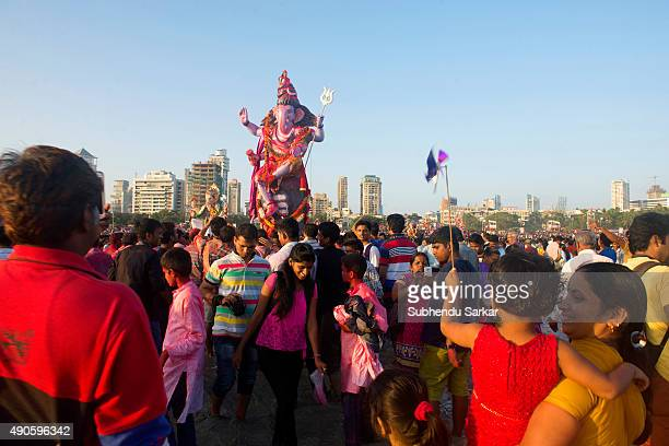 People gather at Girgaum Chowpatty in Mumbai for the immersion of lord Ganesha Ganesha Chaturthi or Ganapati festival is celebrated in honour of the...