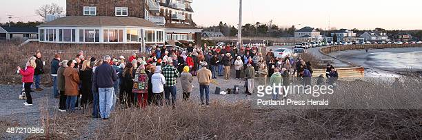 People gather at Kennebunk Beach for an ecunemical sunrise Easter service on Sunday April 20 2014 About 150 people attended the service which was...