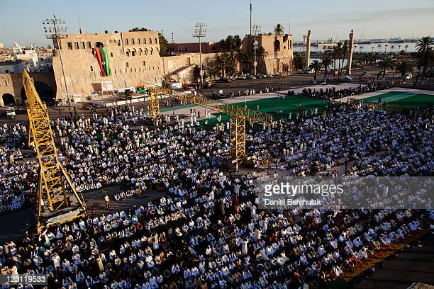 People gather at Martyr Square formerly known as Green Square for the Eid AlFitr prayer on August 31 2011 in Tripoli Libya Libyans celebrated the...