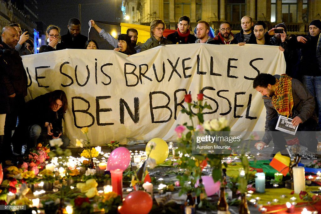 People gather at Place de la Bourse in support of the victims after the terrorist attacks on March 22, 2016 in Brussels, Belgium. At least 31 people are thought to have been killed after Brussels airport and a Metro station were targeted by explosions. The attacks come just days after a key suspect in the Paris attacks, Salah Abdeslam, was captured in Brussels.