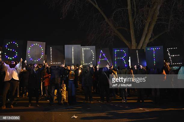 People gather at Place de la Nation following a mass unity rally following the recent terrorist attacks on January 11 2015 in Paris France An...