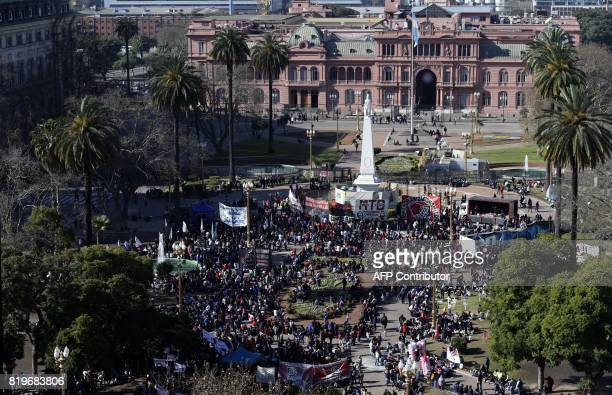 People gather at Plaza de Mayo square where members of social organizations prepare stew in soup kitchens during a protest against the economy policy...