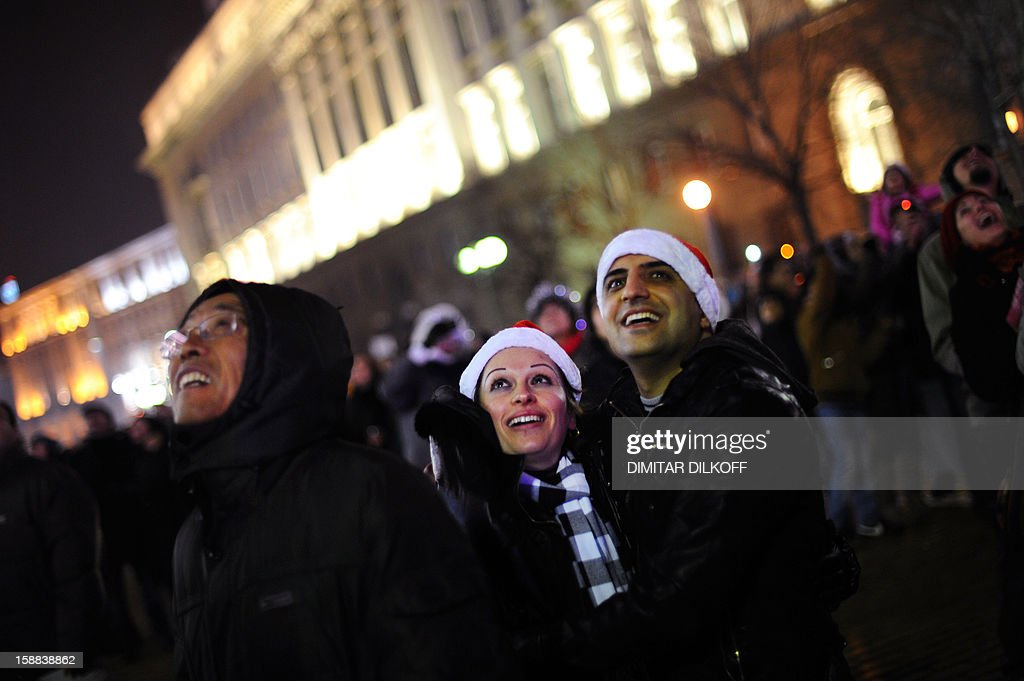 People gather at Sofia's Alexander Batemberg Square to celebrate the New Year, early January 1, 2013. AFP PHOTO / DIMITAR DILKOFF