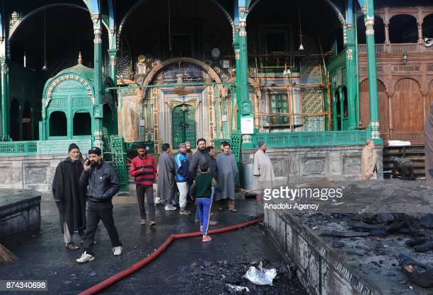 People gather at the 300 year old mosque of Mir Syed Ali Hamadani after a lightning hit in old Srinagar the summer capital of Indian controlled...