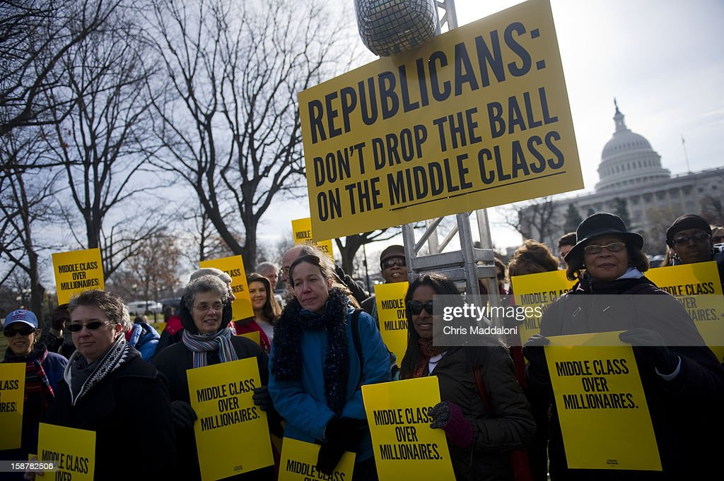 People gather at 'The Action' rally urging the Republicans in Congress 'not to drop the ball on the middle class, and give massive tax breaks to the richest Americans as the New Year and the impending $2,000 tax hike on middle-class families approaches.'