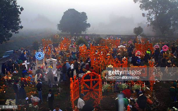 People gather at the cemetery of the Ihuatzio community in Michoacan state Mexico 02 November 2004 during the celebrations of the All Souls' Day AFP...