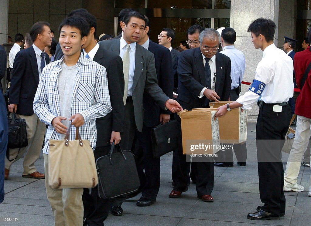People gather at the entrance of the Toyko District Court to get an observer seat for the trial of Shoko Asahara, real name Chizuo Matsumoto on October 31, 2003 in Tokyo, Japan. Defence arguments are coming to a close in the seven and a half year trial of Shoko Asahara, real name Chizuo Matsumoto. A verdict is expected in February next year and if found guilty Asahara faces the death penalty. Asahara stands accused of masterminding the 1995 Sarin gas attack on Tokyo's subway, in which 12 people died and a further 5,000 were poisoned.