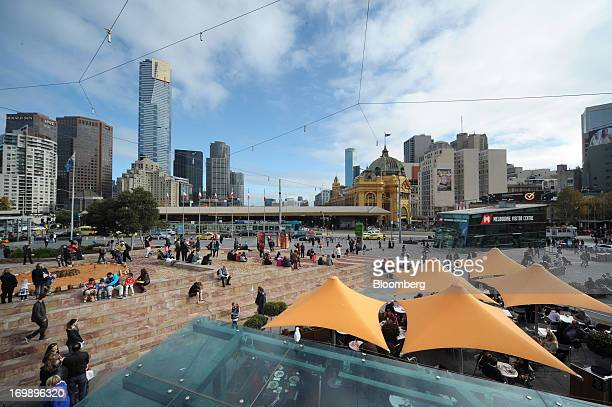 People gather at the entrance to Federation Square in central Melbourne Australia on Sunday June 2 2013 The Australian Bureau of Statistics is...