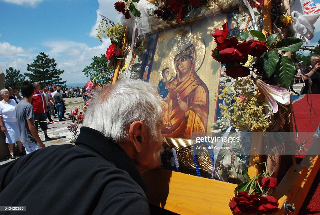 People gather at the Gazimestan monument to celebrate the St. Vitus Day in Pristina, Kosovo on June 28, 2016.