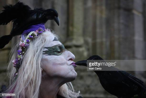 People gather at the Glastonbury Market Cross as they celebrate Samhain at the Glastonbury Dragons Samhain Wild Hunt 2017 in Glastonbury on November...