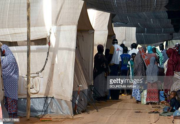 People gather at the health center of Lazaret near Niamey on April 23 where are treated patients suffering from meningitis The death toll in a...