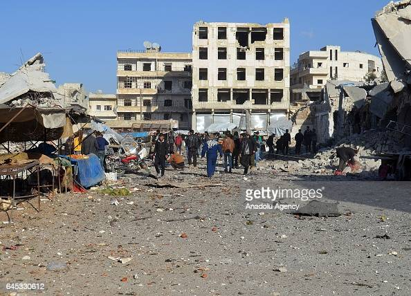 People gather at the impact site after Assad Regime's airstrike over civilians in residential areas of Ariha town of Idlib Syria on February 25 2017...