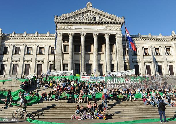 People gather at the Legislative Palace in Montevideo during the Global Climate March to demand action on climate change telling world leaders on the...