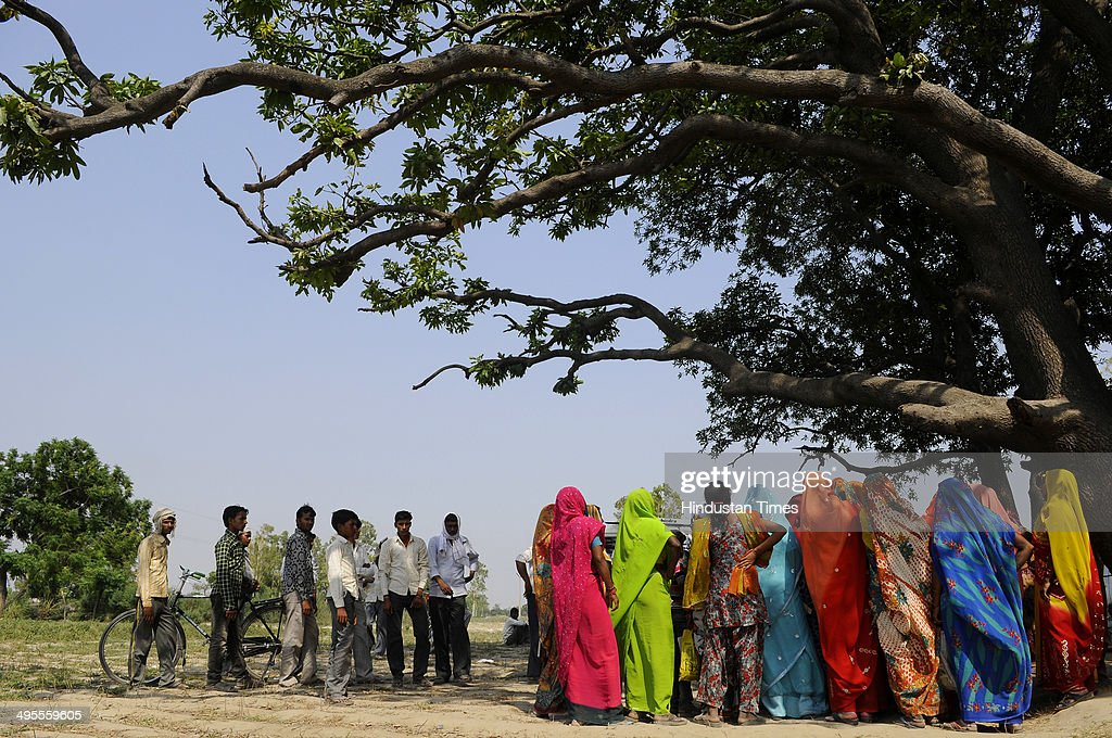 People gather at the Mango tree where victims of Badaun Rape case were found hanging at Katra Sadatganj village on June 4 2014 in Badaun India Two...