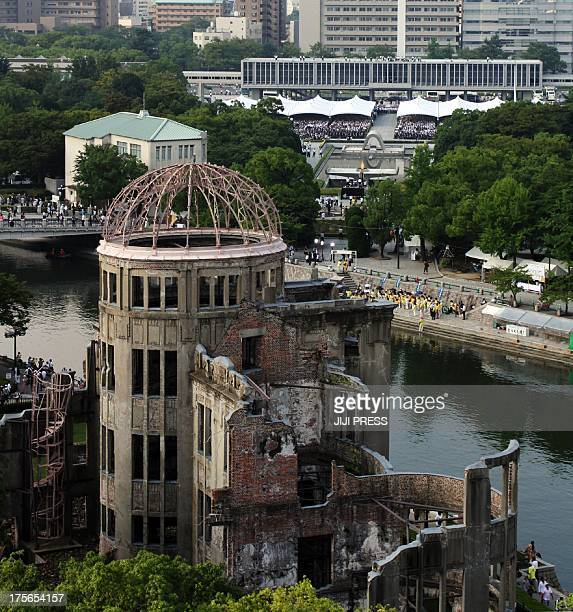 People gather at the Peace Memorial park behind the Abomb Dome to offer prayers for Abomb victims in Hiroshima western Japan on August 6 2013 as...
