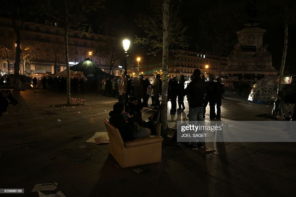 People gather at the Place de la Republique in Paris during a protest by the Nuit Debout, or 'Up All Night' movement who have been rallying against the French government's proposed labour reforms on April 29, 2016. Twenty-seven people were arrested and 24 detained during the overnight clashes in the French capital as the police dispersed the protesters who began their began movement on March 31 in opposition to the government's proposed labour reforms.