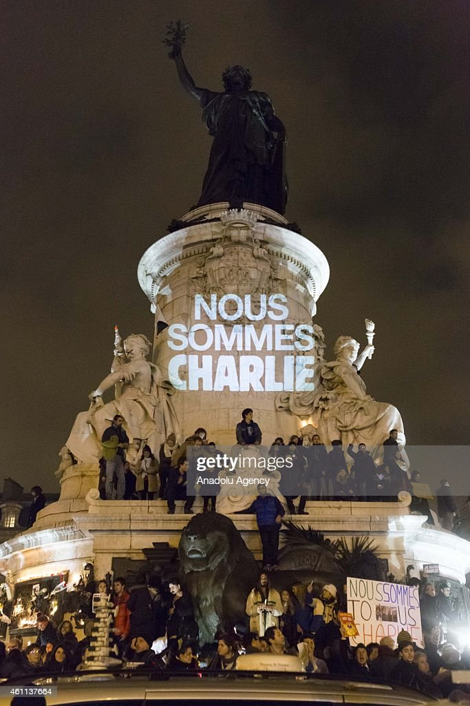 People gather at the Place de la Republique (Republic Square) to protest against gun attack on the building of French magazine 'Charlie Hebdo', leaving 12 dead, in Paris, France, on January 7, 2015.