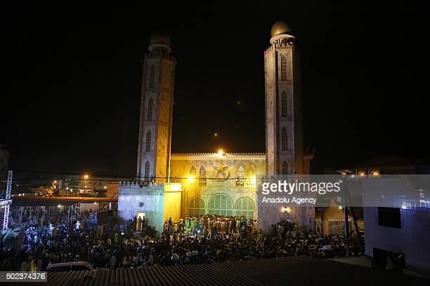 People gather at the Serigne Mbaye Sy Mosque for the Mawlid al Nabi ceremony marking the birth of the Prophet Muhammad organized by Senegalese Muslim...