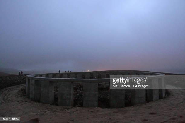 People gather at the site dubbed AchillHenge on Achill Island Co Mayo to watch the Winter Solstice this morning