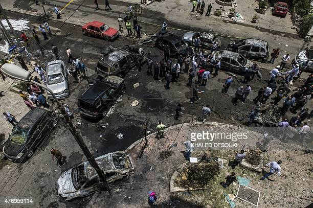 People gather at the site of a bomb that targeted the convoy of the Egyptian state prosecutor Hisham Barakat in the capital Cairo on June 29 2015...