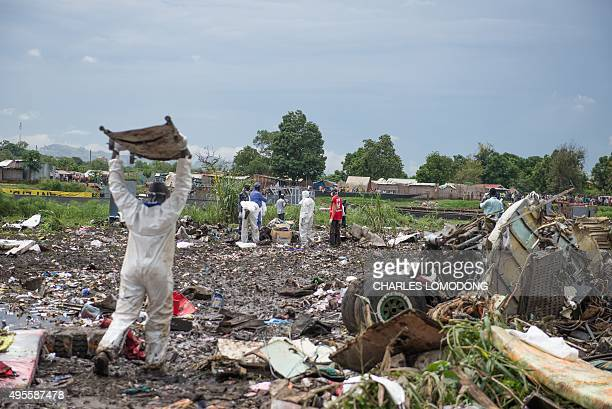 People gather at the site of a cargo plane crash on a small island in the White Nile river close to Juba airport in the Hai Gabat residential area on...