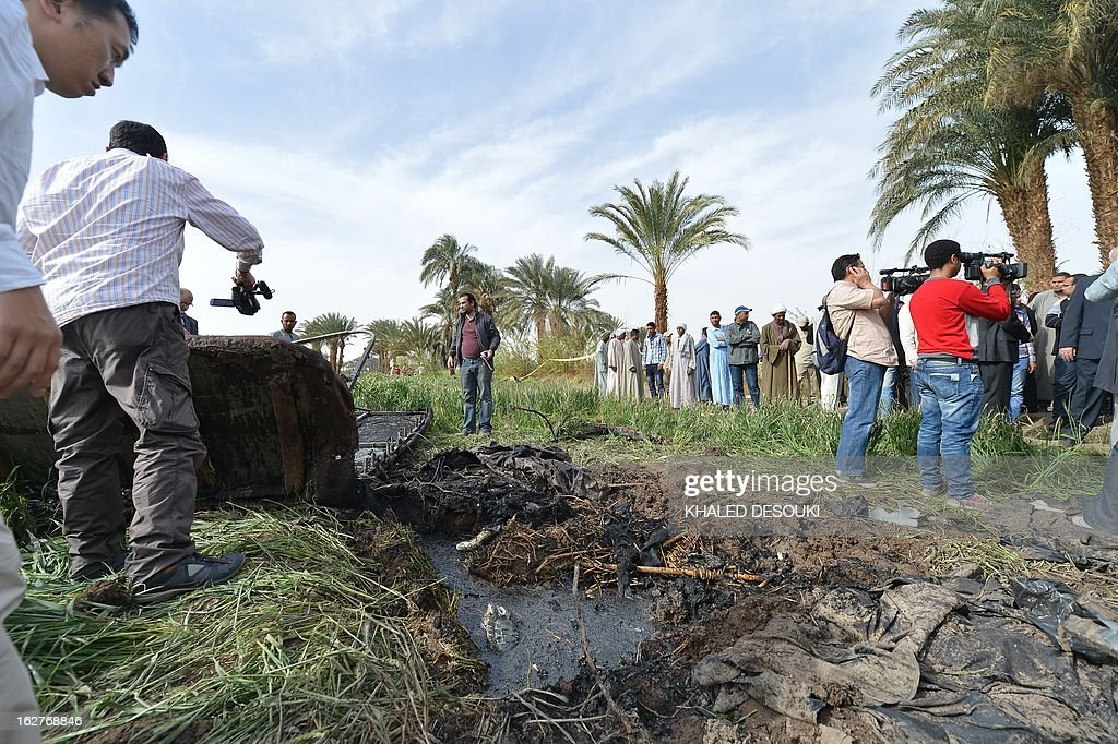People gather at the site of a hot air balloon accident in Luxor on February 26, 2013. A hot air balloon exploded and plunged to earth at Egypt's ancient temple city of Luxor during a sunrise flight, killing up to 19 tourists, including Asians and Europeans, sources said.