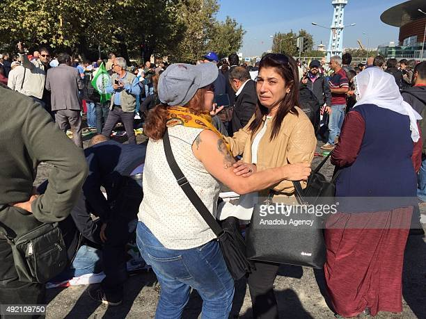 People gather at the site of an explosion close to Ankara's main train station on October 10 2015 in Ankara Turkey