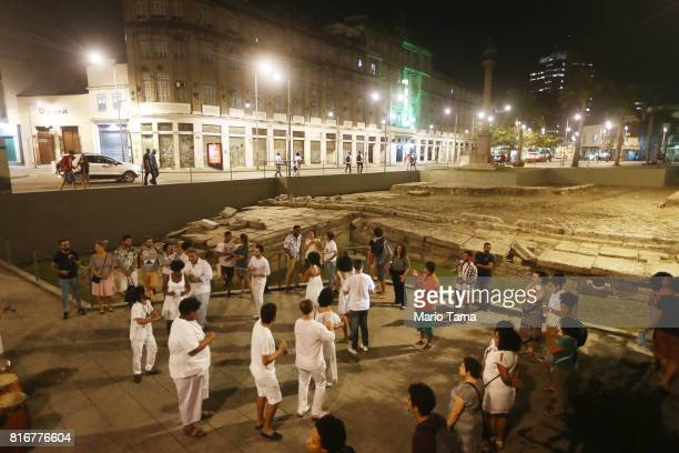 People gather at the Valongo slave wharf entry point in the Americas for nearly one million African slaves on July 17 2017 in Rio de Janeiro Brazil...
