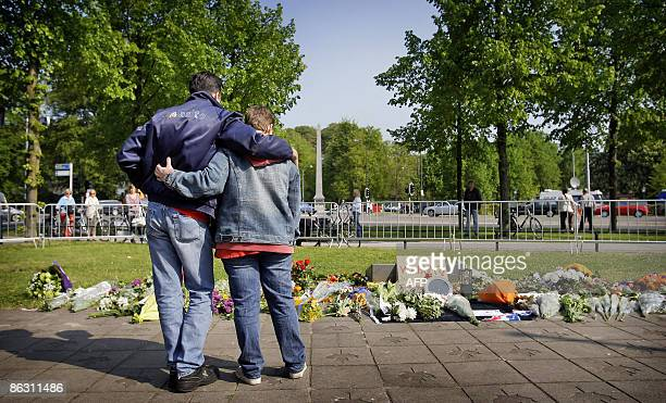 People gather at the war monument in Apeldoorn on May 1 2009 where a man tried to ram his car into the Dutch royal family killing five onlookers at a...