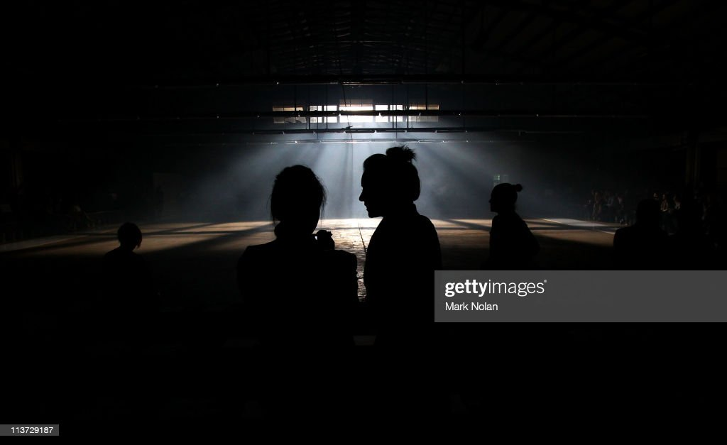 People gather before models showcase designs by Josh Goot on the catwalk during Rosemount Australian Fashion Week Spring/Summer 2011/12 at The Ity...