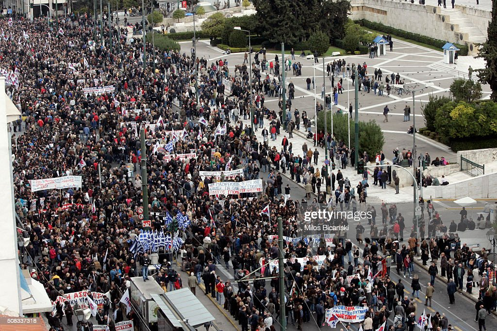People gather during a 24-hour nationwide general strike on February 4, 2016 in Athens, Greece. Clashes have broken out between Greek police and youths throwing fire bombs and stones, as tens of thousands of people march through central Athens to protest planned pension reforms.