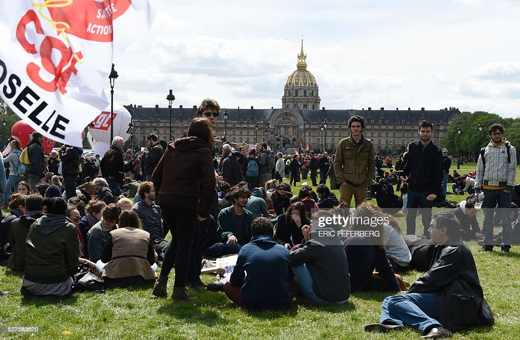 People gather during a demonstration against the government's planned labour law reforms on May 3, 2016, in Paris as French lawmakers begin to examine the contested labour reform bill at the Parliament. Unions fear it will erode the cherished rights of workers on full-time contracts, while student organisations -- who have been at the forefront of the protests -- believe it will fail to create 'real' jobs for young people.
