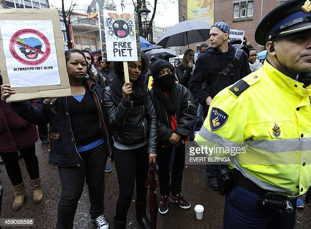 People gather during a demonstration against the tradition of 'Zwarte Piet' or 'Black Pete' the blackfaced companion of Sinterklaas or Sain Nicholas...
