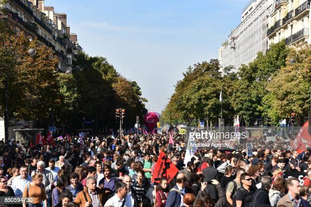 People gather during a national demonstration against the French government's labor reforms in Paris France on September 21 2017