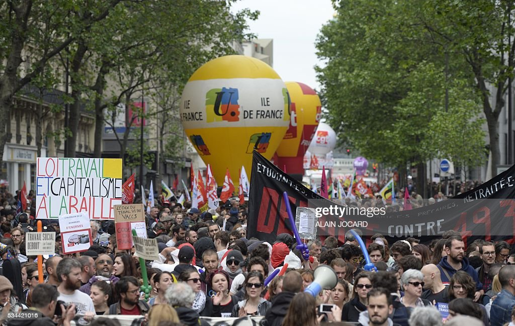 People gather during a protest against the government's labour market reforms in Paris, on May 26, 2016. The French government's labour market proposals, which are designed to make it easier for companies to hire and fire, have sparked a series of nationwide protests and strikes over the past three months.