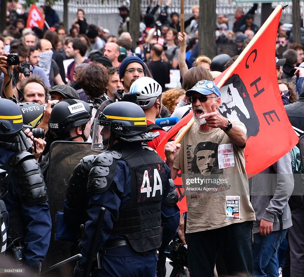 People gather during a protest against the new labor law also known as the 'El Khomri law' which has recently proposed by Labor Minister Myriam El Khomri in Paris, France on June 28, 2016. Country-wide protests and strikes, led by uniuons has been continuing for weeks.