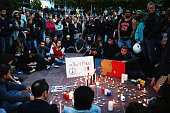 People gather during a vigil in Aotea Square to remember victims of the Paris attacks on November 14 2015 in Auckland New Zealand According to...