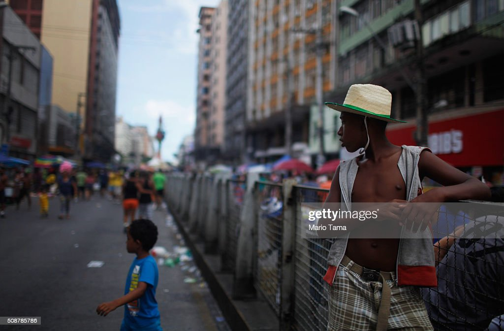 People gather during Carnival celebrations on February 6, 2016 in Recife, Pernambuco state, Brazil. Carnival celebrations continued in the city in spite of concerns over the Zika virus.