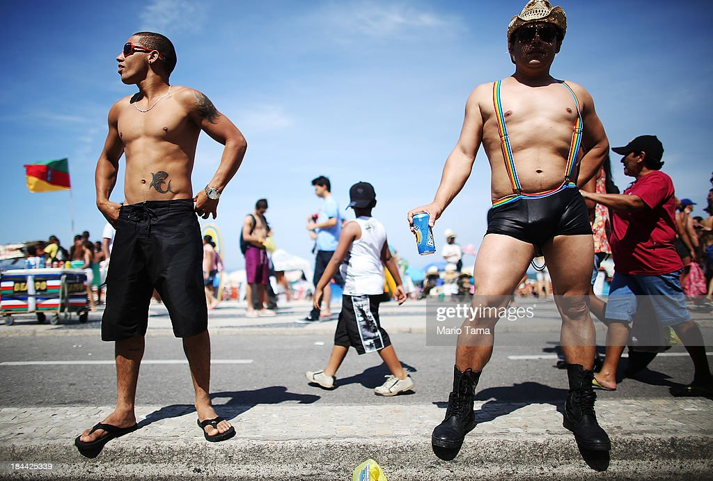 People gather during Rio de Janeiro's 18th Gay Pride Parade along Copacabana Beach on October 13, 2013 in Rio de Janeiro, Brazil. Brazil is the world's largest Catholic nation with an estimated 60,000 gay couples. In May, Brazil became the third country in Latin America to effectively approve same-sex marriage via a court ruling, but a final law has yet to be passed.